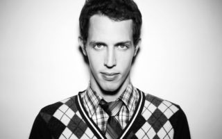 a black and white photograph of the standup comedian Tony Hinchcliffe